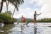 A family enjoys learning how to standup paddle on the Wailua River, Kaua'i.