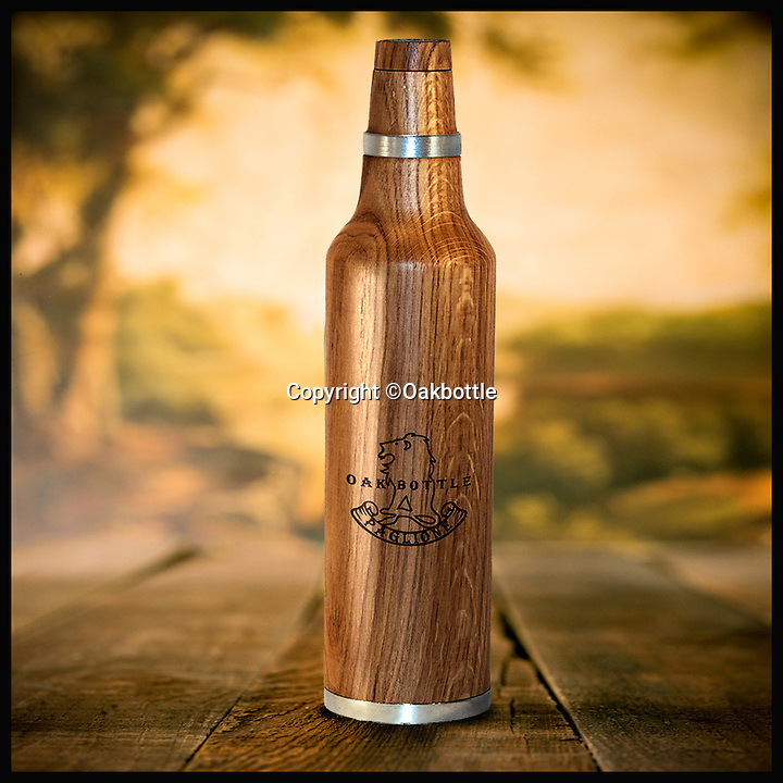 BNPS.co.uk (01202 55883)<br /> Pic: Oakbottle/BNPS<br /> <br /> *Please use full byline*<br /> <br /> The Oakbottle.<br /> <br /> This simple wooden bottle could be about to change the face of the lucrative drinks industry - because it promises to turn cheap booze into more expensive vintage-tasting drinks.<br /> <br /> The oak bottle replicates the ageing process of wines and spirits during which they sit in oak barrels and develop their flavour - but instead of taking months or years its makers say it takes as little as 24 hours to achieve the same effect.<br /> <br /> It means drinks lovers could potentially enjoy the oaky flavours of premium tipples without having to fork out the high prices they demand.  <br /> <br /> The original Oak Bottle, made from sustainably sourced American oak, costs $79.99 - around &pound;50 - from oakbottle.com.