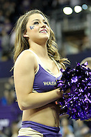 December 22, 2013:  Washington cheerleader Paige Snider entertained fans during a timeout against Connecticut.  Connecticut defeated Washington 82-70 at Alaska Airlines Arena Seattle, Washington.