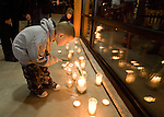 Four-year-old Dustin Piper lights a candle during a candle light prayer vigil at the Champion's Centre for family members, friends and law enforcement officers for four Lakewood Police officers killed at a Lakewood coffee shop on Sunday, Nov. 29, 2009.  At about 8:00 a.m. Sunday morning, a gunman walked into the Forza Coffee shop and while the four police officers were having coffee before their shift started, he opened fire, killing all four law enforcement officers.  Jim Bryant Photo. ©2010. ALL RIGHTS RESERVED.