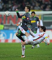 FUSSBALL   1. BUNDESLIGA  SAISON 2011/2012   16. Spieltag FC Augsburg - Borussia Moenchengladbach            10.12.2011 Patrick Herrmann (li, Borussia Moenchengladbach) gegen Paul Verhaegh (FC Augsburg)