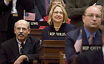 HARTFORD, CT- 07 JANUARY 2008 --010709JS08-Rep. Roberta B. Willis, D-Lakeville, and her husband Bill Willis, left, listens to the Speaker of the House  Wednesday during the opening day of the general assembly at state Capitol in Hartford. <br /> Jim Shannon / Republican-American