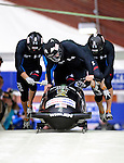 22 November 2009:  Steven Holcomb, piloting the USA 1 bobsled, leads his 4-man team to a first place finish at the FIBT World Cup competition, in Lake Placid, New York, USA. Mandatory Credit: Ed Wolfstein Photo