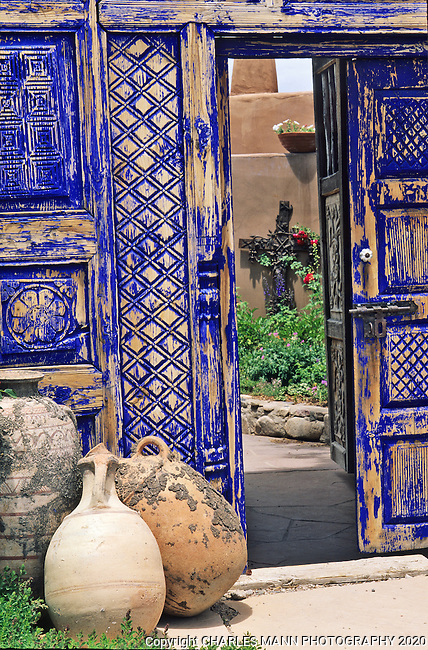 A cobalt blue color scheme creates a lot of drama and anticipation at the entry to this Santa Fe garden.