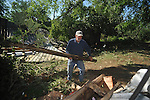 John Warren helps clear J.D. Jones house on County Road 269 in the Pine Flat area of Lafayette County south of Oxford, Miss. on Thursday, April 28, 2011. A Wednesday afternoon storm destroyed houses and uprooted trees.