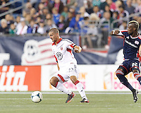 D.C. United midfielder Perry Kitchen (23) dribbles at midfield.  In a Major League Soccer (MLS) match, the New England Revolution (blue) defeated D.C. United (white), 2-1, at Gillette Stadium on September 21, 2013.