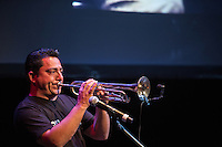 Alex Escobar plays the trumpet during supergroup Mexrrissey's performance at the Perelman Theater in Philadelphia on October 30, 2016.
