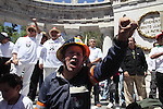Mexican electric workers march during a rally to protest against the president Calderon's decision to dissolve the Luz y Fuerza del Centro state company and demanding the federal government to reverse the decision of dissolving the Luz y Fuerza del Centro state company, March 20, 2010. Photo by Heriberto Rodriguez