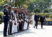 Chairman of the Joint Chiefs of Staff Admiral Mike Mullen (L), United States President Barack Obama and U.S. Secretary of Defense Leon Panetta (R) walk through an honor cordon before laying a wreath on the during a remembrance ceremony at the Pentagon in Washington, DC, on Sunday, September 11, 2011. .Credit: Joshua Roberts / Pool via CNP