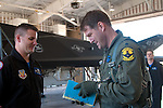 Lt. Col. Chris 'Hans' Knehans, 7th Fighter Squadron commander, inspects his F-117A aircraft with the assistance of the F-117 Demo Team prior to the Silver Stealth Formation Flight.