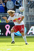 ..Red Bull defender Stephen keel (22) heads the ball...Sporting Kansas City defeated New York Red Bulls 2-0 at LIVESTRONG Sporting Park, Kansas City, Kansas.