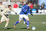 3 December 2006: UCSB's Nick Perera (14) dribbles away from UCLA's Michael Stephens (13). California-Santa Barbara defeated California-Los Angeles 2-1 at Robert R. Hermann Stadium in St. Louis, Missouri in the NCAA men's college soccer tournament final game to win the 2006 NCAA Championship.