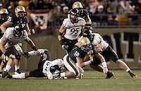 PITTSBURGH, PA - NOVEMBER 05:  Tino Sunseri #12 of the Pittsburgh Panthers is tackled by J.K. Schaffer #37 of the Cincinnati Bearcats on November 5, 2011 at Heinz Field in Pittsburgh, Pennsylvania.  (Photo by Jared Wickerham/Getty Images)