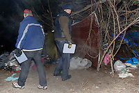 NWA Democrat-Gazette/DAVID GOTTSCHALK - 1/30/15 -  Jon Woodward (right), chief executive officer of Seven Hills Homeless Center, and Kevin Fitzpatrick,  professor of sociology and director of the University of Arkansas' Community and Family Institute, approach a tent in the woods south of Martin Luther King Jr. Boulevard in Fayetteville Friday January 30, 2015 in the predawn hours. Areas with a homeless population were visited during the  Northwest Arkansas' biennial, 24-hour homeless census.