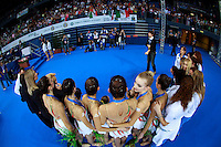 Anzhelika Savrayuk of Italy turns to camera during Italian group photos  after winning gold in event finals at 2009 Pesaro World Cup on May 2, 2009 at Pesaro, Italy.  Photo by Tom Theobald.