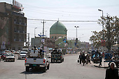 KIRKUK, IRAQ:  An Iraqi police convoy drives through the streets of Kirkuk...Security is tightened in the volatile Iraqi city of Kirkuk the day before the national elections.  Kirkuk is home to Kurds, Arabs, and Turkmen and has been so violently divided that the city could not participate in the 2005 elections.