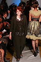 Fashion designer Marlene Thomas walks runway with models at the close of her Marlene Haute Couture Evening Collection fashion show, during Plitzs Fashion Week New York Fall 2012.