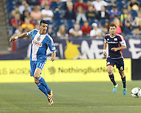 Philadelphia Union forward Sebastien Le Toux (11) redirects the ball. In a Major League Soccer (MLS) match, the New England Revolution (dark blue) defeated Philadelphia Union (light blue), 5-1, at Gillette Stadium on August 25, 2013.