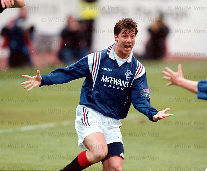 Brian Laudrup wheels away in delight after scoring to win the league and clinch nine-in-a-row for Rangers at Tannadice in May 1997