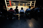Wheelchair-bound members of the audience watch on as wrestlers do battle during a bout at  Doglegs, an event for wrestlers with physical and mental handicaps in Tokyo, Japan.