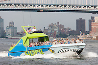 Circle LIne Shark speedboat on the East River approaching its stop at South Street Seaport Pier 16