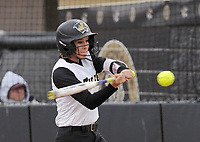 NWA Democrat-Gazette/BEN GOFF @NWABENGOFF<br /> Morgan Nelson of Bentonville grounds out against Van Buren Thursday, March 16, 2017, during the softball game at Bentonville's Tiger Athletic Complex.