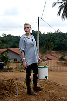 In a rehabilitation village fro Tsunami affected Sri lankans, Scarlett holds an award winning bucket designed by Oxfam.