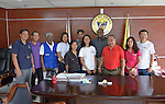 Representatives of the ACT Alliance, including General Secretary John Nduna (fourth from right) pose with Edward Codilla (third from right), the mayor of Ormoc, a city in the Philippines province of Leyte that was hit hard by Typhoon Haiyan in November 2013. The storm was known locally as Yolanda. ACT Alliance members have been providing a variety of forms of assistance to survivors here, and Mayor Codilla wrote the Geneva-based network to express his appreciation. Nduna included Ormoc in a February 2014 visit to typhoon-affected communities to learn first hand about the network's emergency response and long-term plans for recovery and rehabilitation.