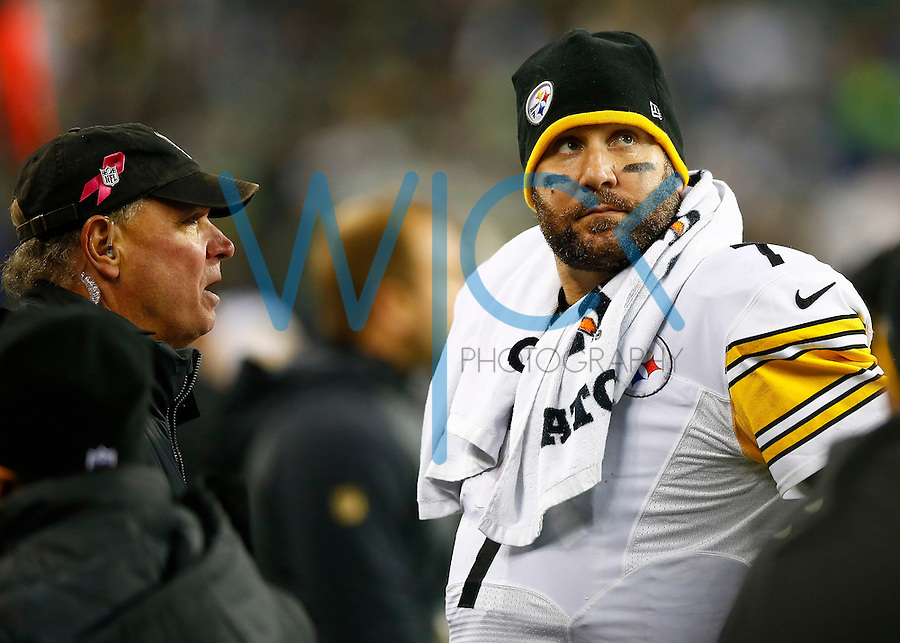 Ben Roethlisberger #7 of the Pittsburgh Steelers looks on from the sideline while talking with team doctors late in the fourth quarter against the Seattle Seahawks before leaving the field during the game at CenturyLink Field on November 29, 2015 in Seattle, Washington. (Photo by Jared Wickerham/DKPittsburghSports)