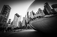 "Chicago ""The Bean"" Cloud Gate sculpture in black and white with a reflection of downtown Chicago city buildings."
