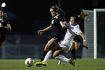 09 October 2014: North Carolina's Darcy McFarlane (right) earns a yellow card for this tackle of Wake Forest's Maddie Huster (left). The University of North Carolina Tar Heels hosted the Wake Forest University Demon Deacons at Fetzer Field in Chapel Hill, NC in a 2014 NCAA Division I Women's Soccer match. UNC won the game 3-0.