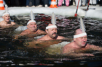 Moscow, Russia, 08/03/2010..Men of the Moscow Ice Swimming Club swimming in ballerinas costumes in a frozen lake during International Women's Day celebrations in northern Moscow. The club always hold their end of season party on Women's Day.