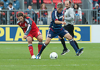 21 April 2012: Chicago Fire midfielder Logan Pause #12 and Toronto FC midfielder Torsten Frings #22 in action during the second half in a game between the Chicago Fire and Toronto FC at BMO Field in Toronto..The Chicago Fire won 3-2...