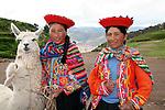 Americas, South America, Peru, Cusco. Peruvian women with llamas.