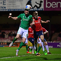 Lincoln City's Jamie McCombe vies for possession with York City's Shaun Rooney<br /> <br /> Photographer Andrew Vaughan/CameraSport<br /> <br /> The Buildbase FA Trophy Semi-Final First Leg - York City v Lincoln City - Tuesday 14th March 2017 - Bootham Crescent - York<br />  <br /> World Copyright &copy; 2017 CameraSport. All rights reserved. 43 Linden Ave. Countesthorpe. Leicester. England. LE8 5PG - Tel: +44 (0) 116 277 4147 - admin@camerasport.com - www.camerasport.com