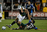 Ramiro Corrales of Earthquakes tries to tackle the ball away from Sal Zizzo of Timbers during the game at Buck Shaw Stadium in Santa Clara, California on August 6th, 2011.   San Jose Earthquakes and Portland Timbers tied 1-1.