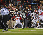 Ole Miss running back Brandon Bolden (34) hurdles Louisiana-Lafayette's Lionel Stokes (24) in Oxford, Miss. on Saturday, November 6, 2010. Ole Miss won 43-21.