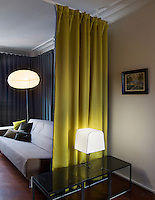 In the living area reversible curtains are used as partitions and to create a sense of privacy