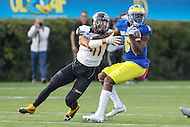 Newark, DE - October 29, 2016: Delaware Fightin Blue Hens wide receiver Jamie Jarmon (6) spins away from Towson Tigers linebacker Jordan Mynatt (41) during game between Towson and Delware at  Delaware Stadium in Newark, DE.  (Photo by Elliott Brown/Media Images International)