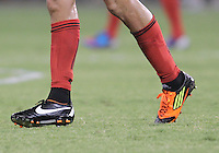 WASHINGTON, DC - July 28, 2012:  Emilliano Dudar (19) of DC United broke a shoe and had a mismatched replacement late in the game against PSG (Paris Saint-Germain) in an international friendly match at RFK Stadium in Washington DC on July 28. The game ended in a 1-1 tie.