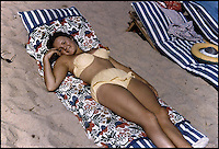 BNPS.co.uk (01202 558833)<br /> Pic: CherryHarker/BNPS<br /> <br /> Cherry Harker in Monaco in 1958 when she was 17.<br /> <br /> While most people her age are enjoying retirement, 'older-preneur' Cherry Harker has launched a new swimwear brand for the active beach babe.<br /> <br /> In her youth Cherry, 76, knew all too well the perils of wardrobe malfunctions from trying to do watersports in a bikini while on holiday in glamorous resorts like Monaco, Cannes and St Tropez.<br /> <br /> But it wasn't until she got bored in her senior years that the impressive septuagenarian, who has already beaten breast and cervical cancer, decided to tackle the problem for the sporty beachgoer.<br /> <br /> ZwimZuit is a range of bold, panelled bikinis made from high quality neoprene, the material used to make wetsuits, and Cherry says her bikinis stay in place no matter what you do.
