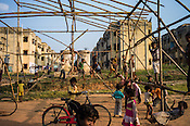 Children play in the grounds in Belgharia township outside of Dhanbad in Jharkhand, India. Families from various villages with underground fires have been rehabilitated in Belgharia township. Photo: Sanjit Das/Panos