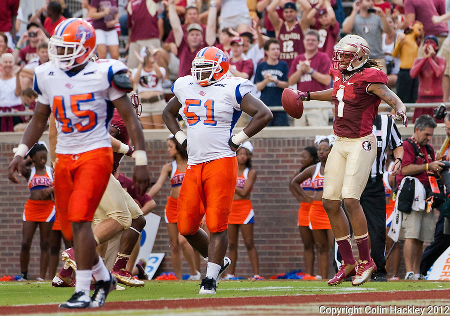 TALLAHASSEE, FL 9/8/12-FSU-SAVANNAH090812CH-Florida State's Kelvin Benjamin celebrates a touchdown as Savannah State's Trevion Ashford, left, and Wayne Burden react during first half action Saturday at Doak Campbell Stadium in Tallahassee. .COLIN HACKLEY PHOTO