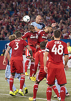 09 March 2013: Sporting KC defender Aurelien Collin #78 battles for a val with Toronto FC midfielder John Bostock #7 and Toronto FC defender Jeremy Hall #25 during an MLS game between Sporting Kansas City and Toronto FC at The Rogers Centre in Toronto, Ontario Canada.