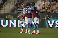 Nathan Delfolineso and  Darren Bent of Aston Villa celebrate Delfolineso's goal during a match between Aston Villa FC and Philadelphia Union at PPL Park in Chester, Pennsylvania, USA on Wednesday July 18, 2012. (photo - Mat Boyle)