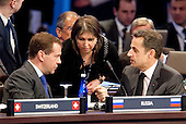 President Dmitry Medvedev of Russia, left, speaks to President Nicolas Sarkozy of France during the opening plenary of the Nuclear Security Summit with UUnited States President Barack Obama at the Washington Convention Center in Washington, D.C., U.S., on Tuesday, April 13, 2010. Ukraine's agreement to relinquish its entire stockpile of highly enriched uranium gave Obama the first concrete result for a summit he convened on securing the world's atomic material. .Credit: Andrew Harrer / Pool via CNP