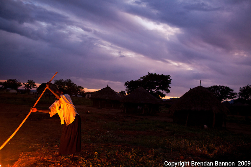 A woman burning grasses in the morning in Madi opei, Northern Uganda.