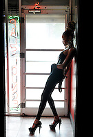 Atlanta artist Joi. Posing in the doorway of Pal's Lounge on Auburn Avenue during a Creative Loafing cover shoot.