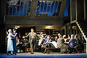 London, UK. 27.10.2014. Jonathan Miller's production, for English National Opera, of LA BOHEME, by Giacomo Puccini, opens at the London Coliseum. Rising star soprano, Angel Blue, makes her role debut as Mimi. Picture shows: David Butt Philip (Rodolfo), George von Bergen (Marcello), Angel Blue (Mimi) and the company. Photograph © Jane Hobson.