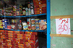 Imported foodstuffs and and expensive sundries on display in a side street shop window in Male, Maldives